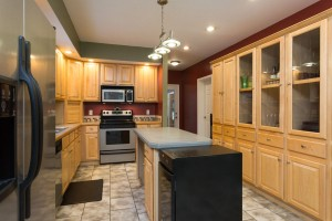 Bright kitchen with ample space for prep and a display for your dishware.